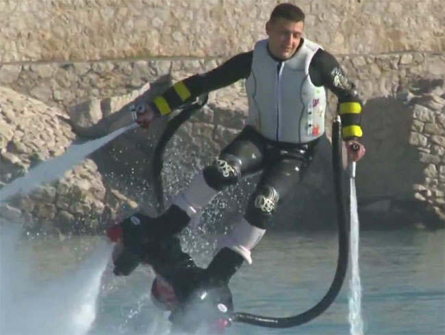 Water jet system makes you fly through air: flyboard